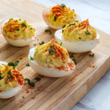 Bacon Cheddar Deviled Eggs on Cutting Board